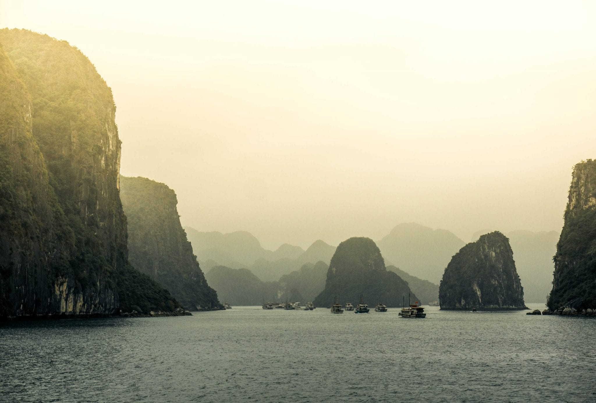 View of the sea and mountains during sunrise at Ha Long Bay in Vietnam