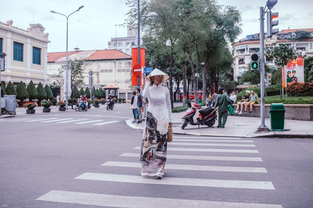 A woman crossing a road in Vietnam.