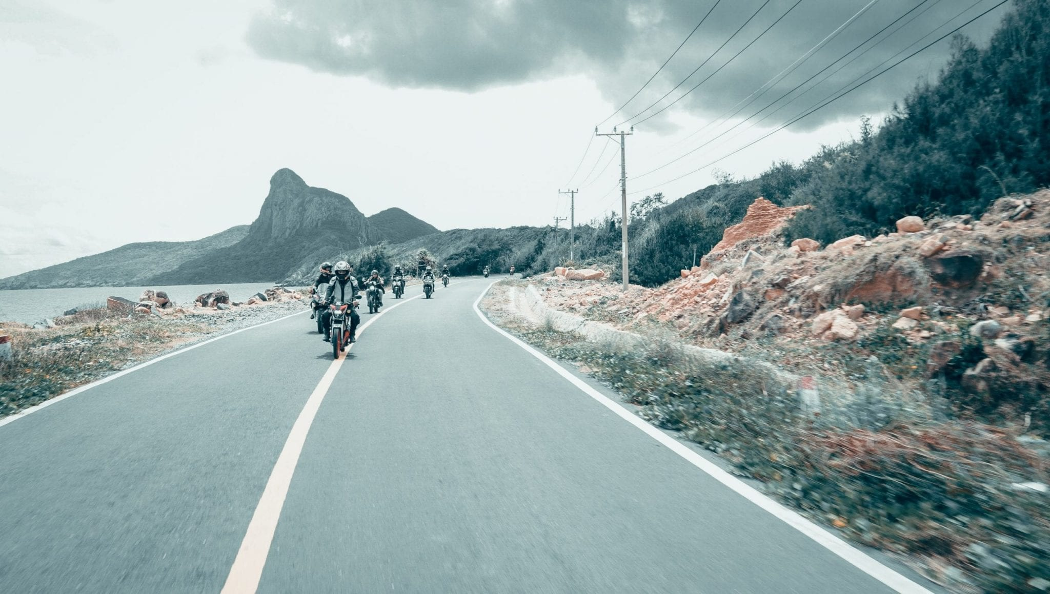 a group of people are riding bikes together at Con dao island, Vietnam