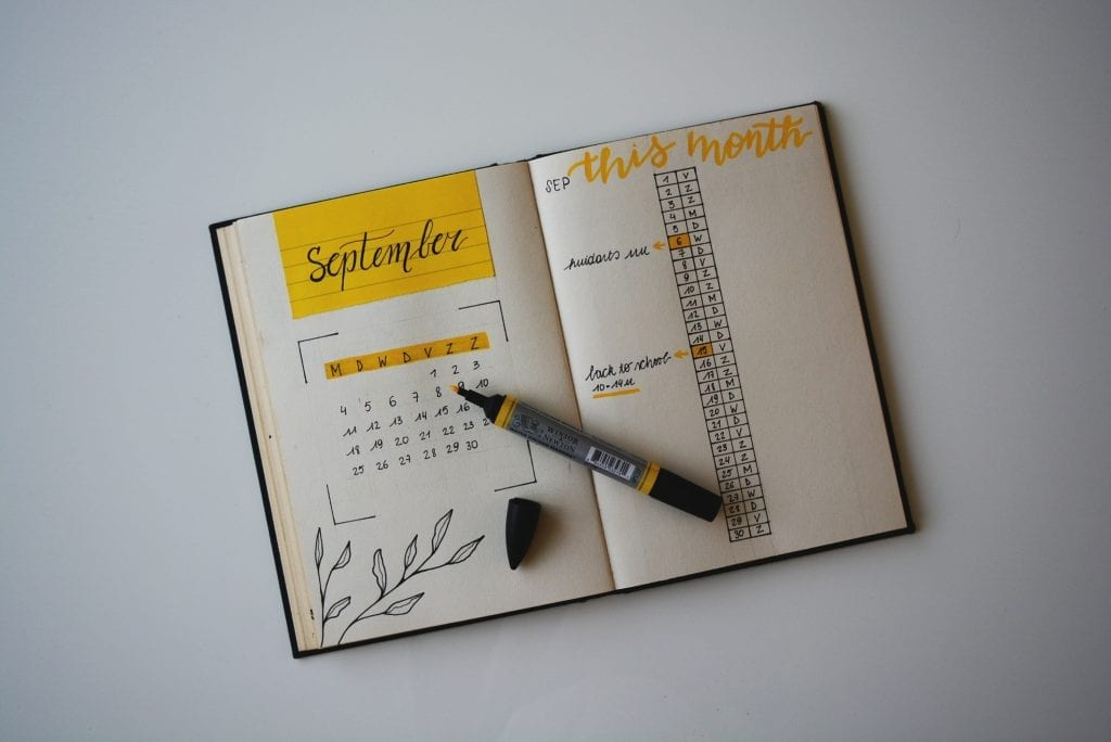 a calendar laying on a white table