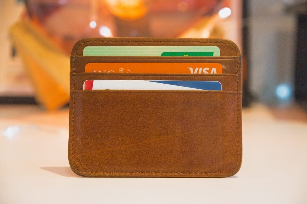 A brown wallet filled with credit cards