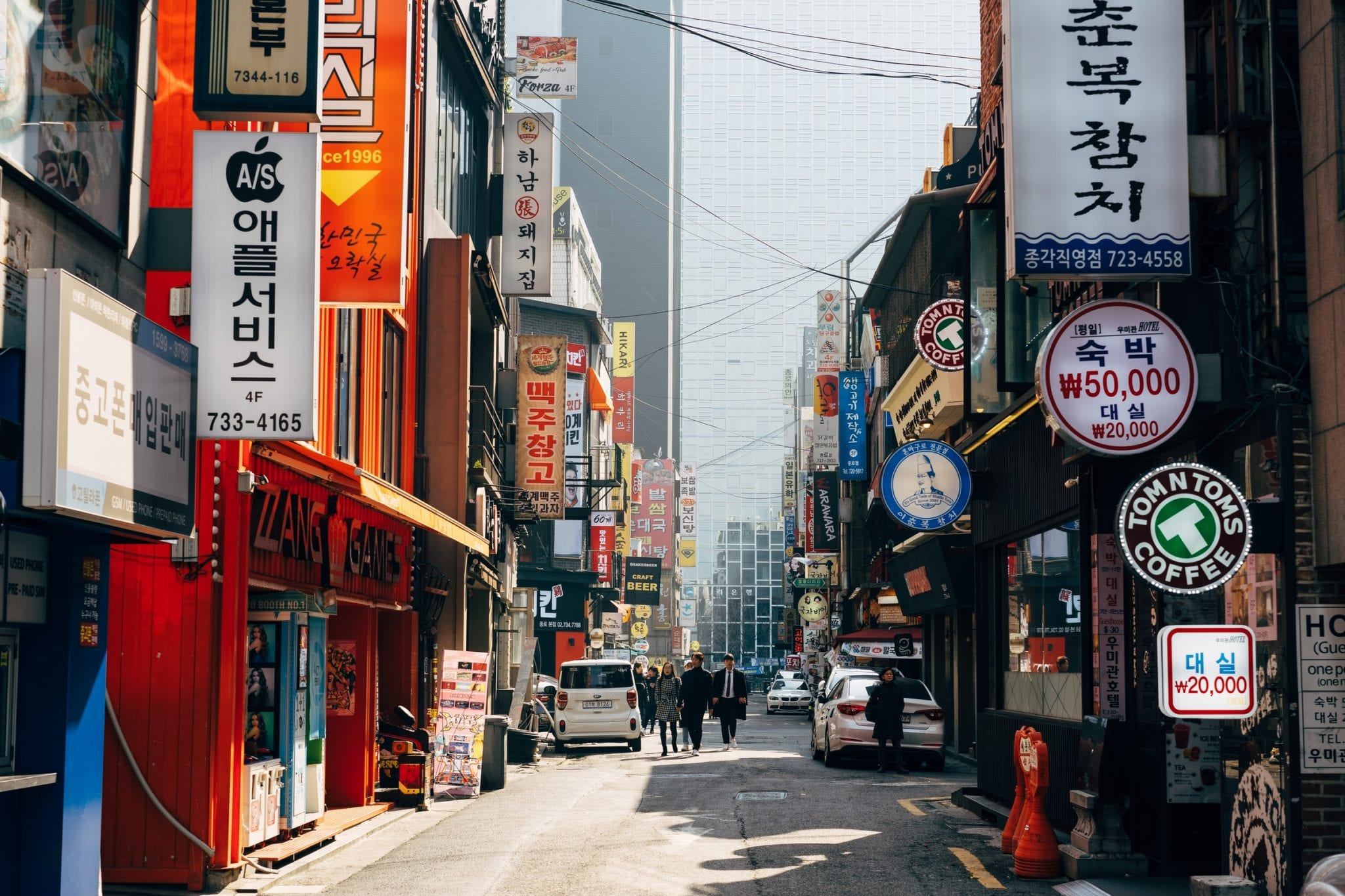 a street in Seoul city with shops and signs in South Korea