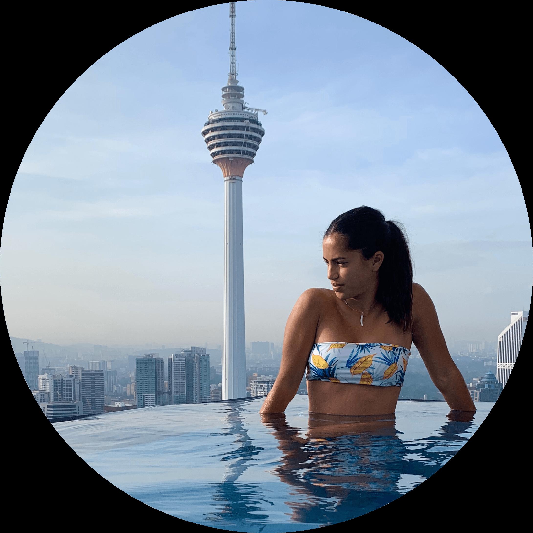 a girl relaxing near petronas tower malaysia