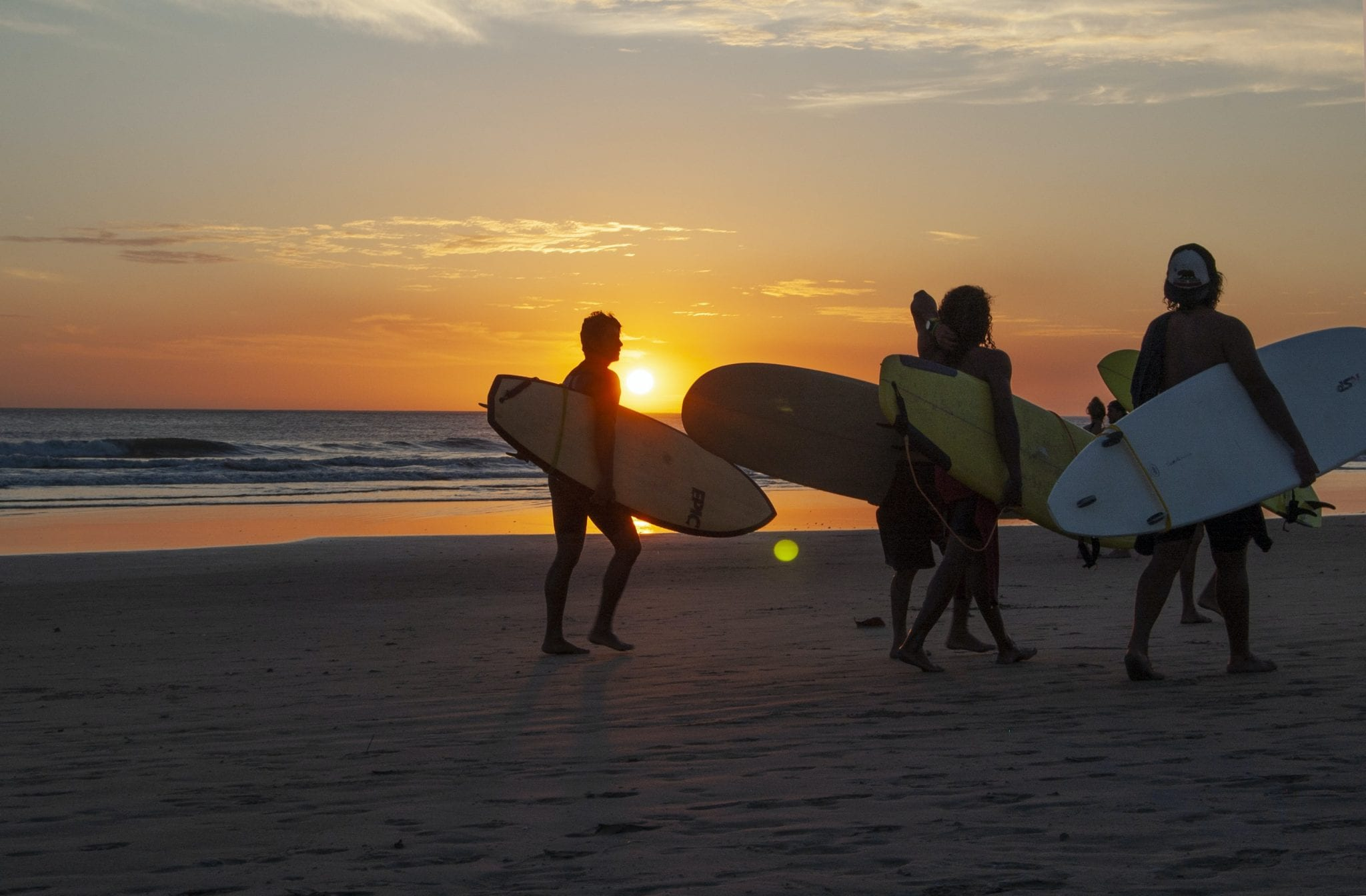friends surf sunset beach costa rica
