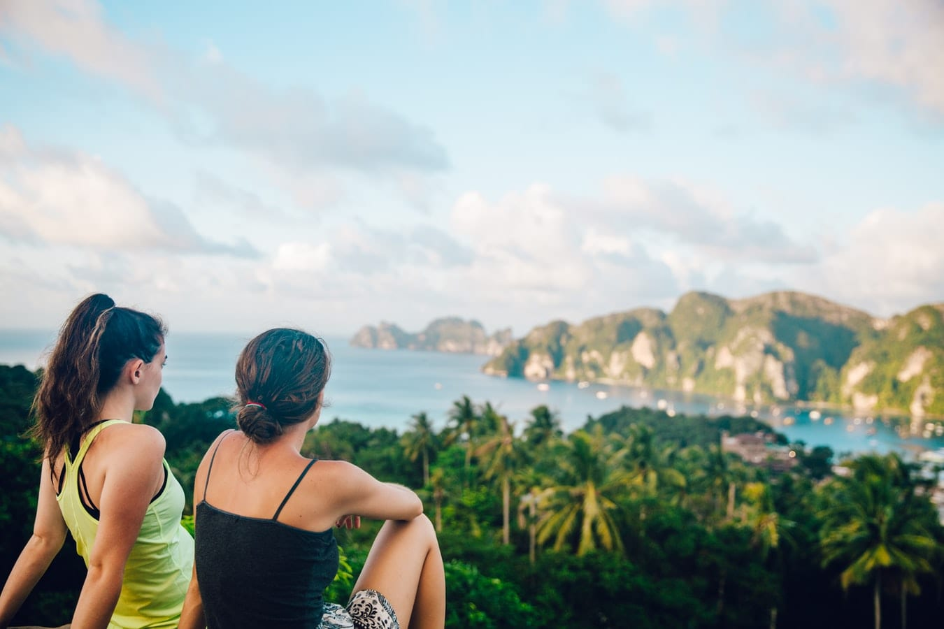 Girls watching a view of forest and ocean in Thailand
